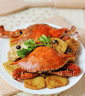 豉香梭蟹炒年糕的做法
